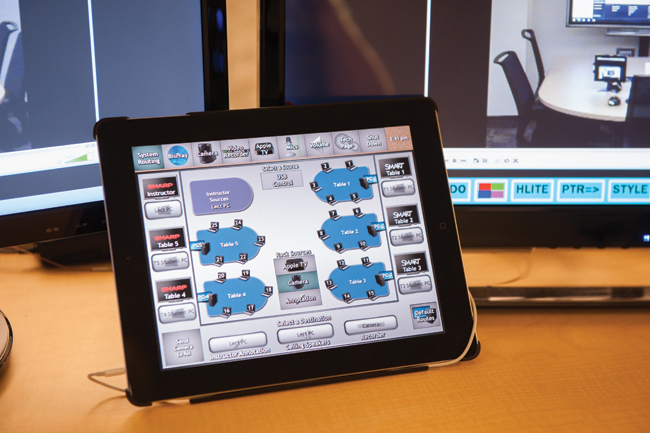 An Apple iPad with the instructor's screen, simplifying control of a comprehensive network-based signal routing system.