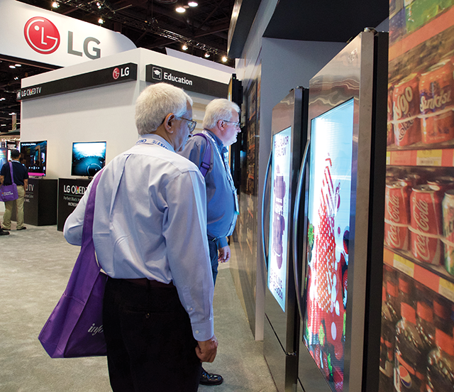 Attendees studied the image quality of LG's new M+ transparent LED display.