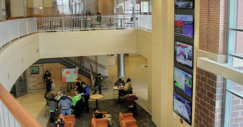 The Alumni Tower located in the main lobby of the DeNaples Student Center features five 70-inch displays. A touchpanel located at the bottom allows students to choose which information is displayed and heard through the sound system.