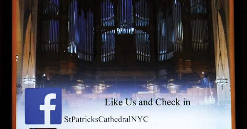 Signage at St. Patrick's Cathedral in New York City links viewers to additional information.