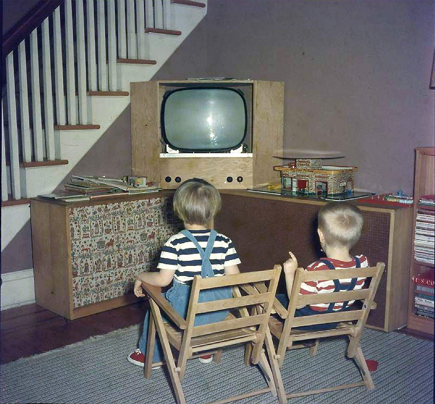 The author and his sister, Mary, watching the TV/hi-fi that their father built. Photo is circa late 1950s.