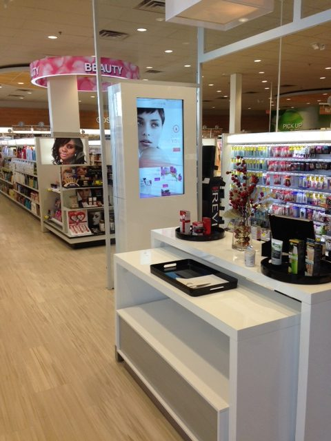 An interactive/virtual sales associate helps women shop by skin condition; and then find their selection at shelf.