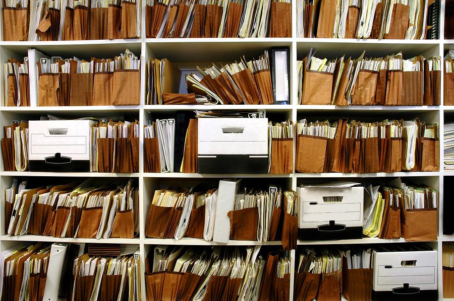 bigstock-office-shelves-full-of-files-a-26172566