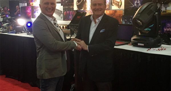 DTS Lighting Sales and Marketing Director Paolo Albani (left) and Group One President Jack Kelly shake hands at the recent WFX Expo on the manufacturer's new US distribution deal