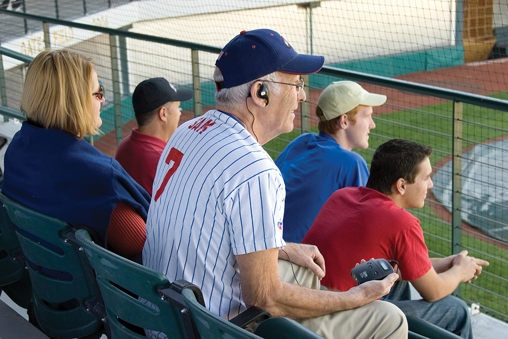 listen-technologies-assistive-listening-man-at-stadium
