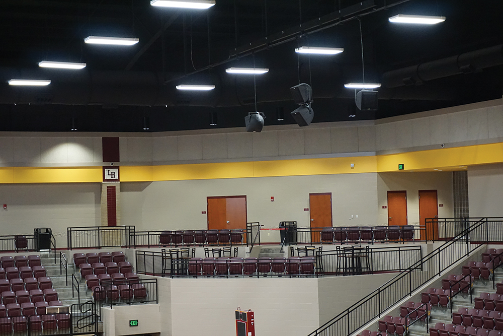 It took some coordination to get the PA speakers hung at the correct angles and elevations that minimize interference with the lighting but are still be above the throwing arc of a basketball in play.