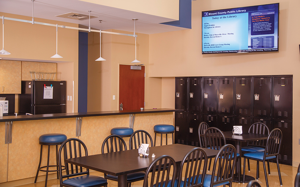 This digital signage display in the kitchen doubles as a display for overflow meetings.