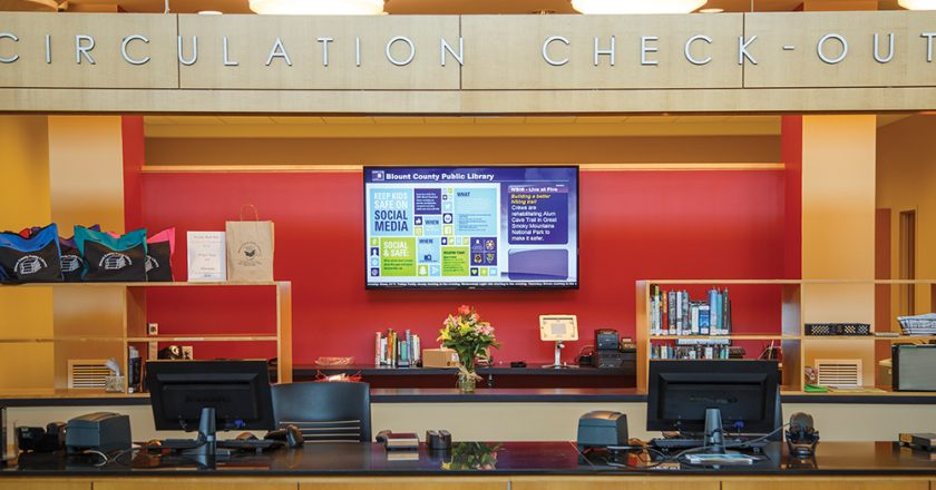 The library's captive audience is never far from digital signage, such as this example at the circulation desk.