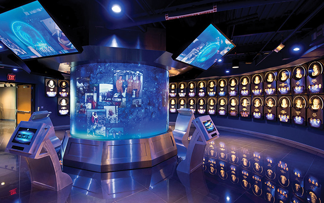 The Hall of Fame's centerpiece is a 10-foot-diameter cylindrical rear-screen projection surface featuring five 8500 lumen projectors that are used to help overcome high ambient light from the LED lighting illuminating the astronaut plaques.