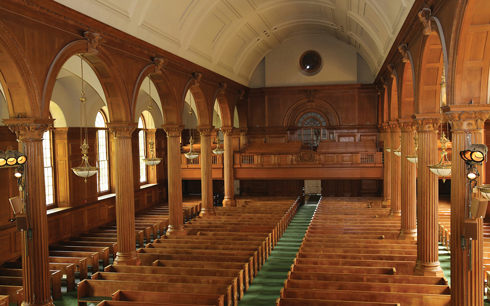 Cochran Chapel's elegant wood paneling, as well as the 12 massive columns lining the center aisle, created many acoustic challenges for Balanced Input to overcome.