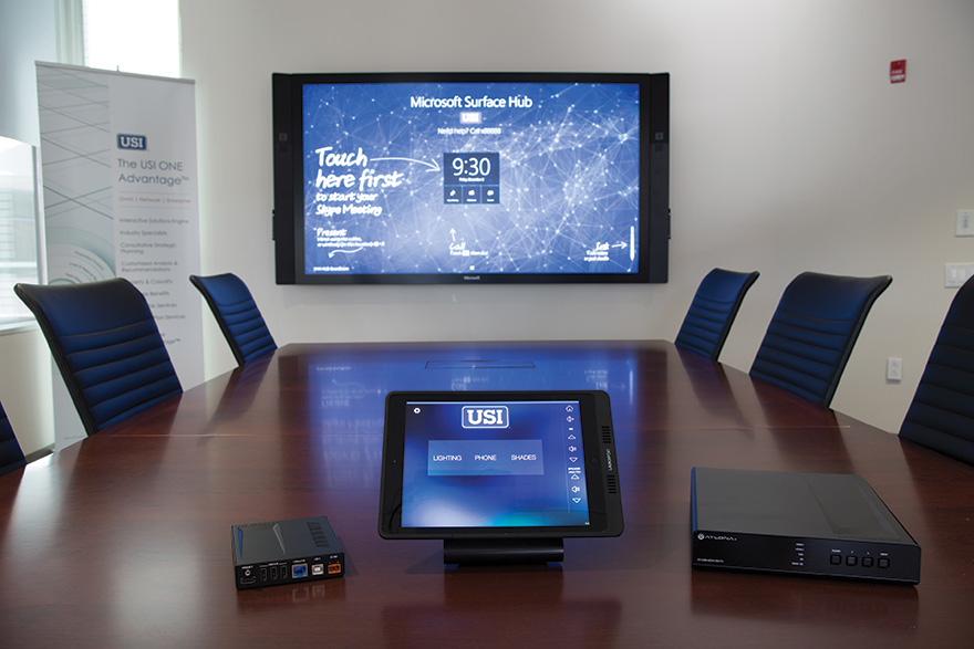 AV components are mounted under the conference tables, and tabletops are generally clear except for iPad tabletop conductive charging stations. This integration strategy resulted in a very clean, clutter-free environment that all eliminates visible cabling and wiring.