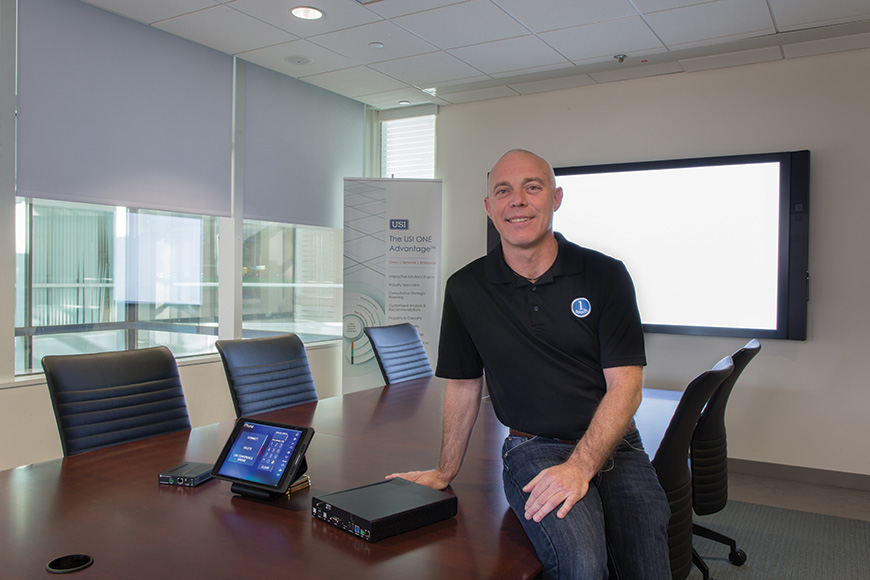 Thomas Duffany of 1 Touch Systems had simplicity for outside presenters in mind when designing the AV systems at USI's Valhalla headquarters. BYOD connectivity was a significant piece of that strategy.