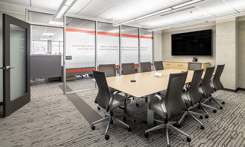 Medium-size conference rooms feature a video camera and microphone for use with UWCI's web-conferencing platform. A touchpanel provides control.
