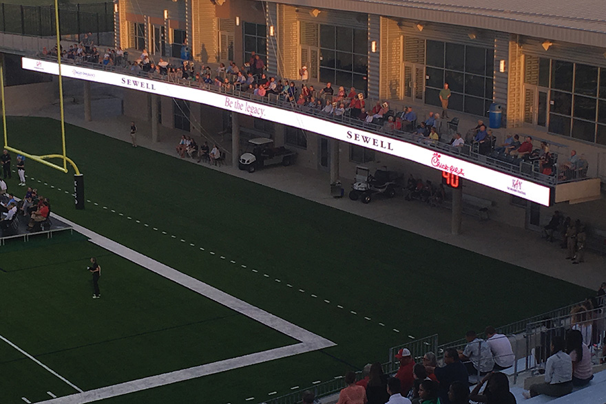 Although large-format LED scoreboards are becoming increasingly common at top-tier secondary schools, Legacy Stadium is the first to get LED ribbons on fascia.