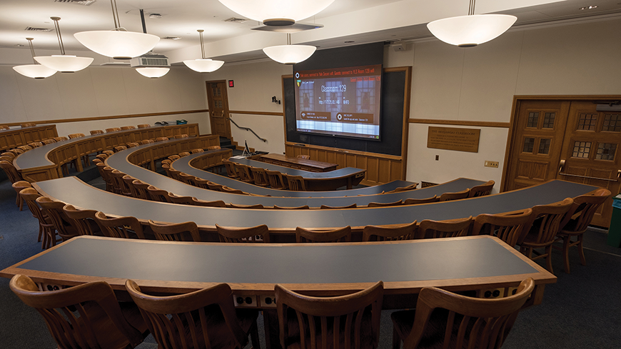 A look at Yale Law School classroom 129. There are dual microphones for lecture capture and a laser projector integrated inside.
