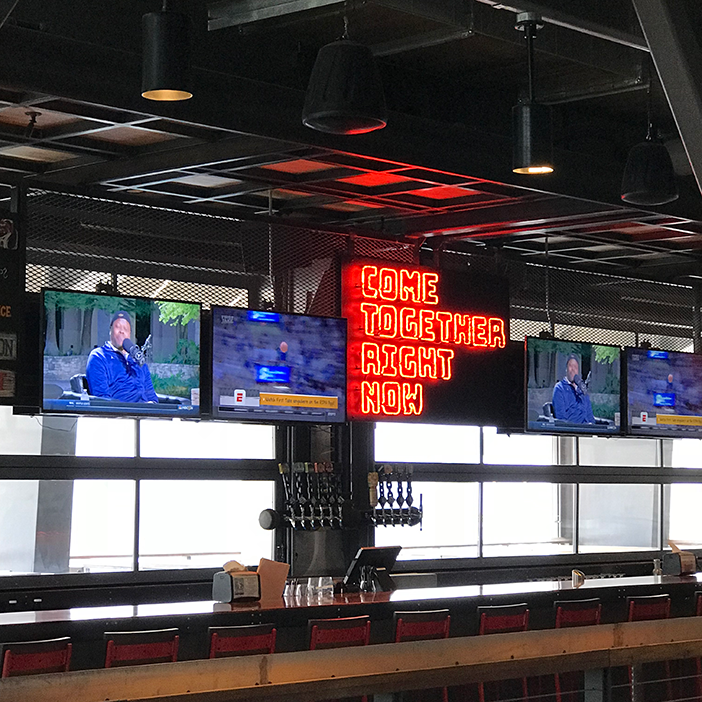Guests in the third-floor bar can enjoy sports and other programming on 50-inch 4K displays.