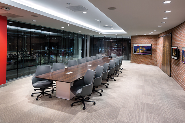 The Executive Meeting Space, located above the retail space, features a 75-inch flatscreen with touch overlay at the far end and a 46-inch on the right