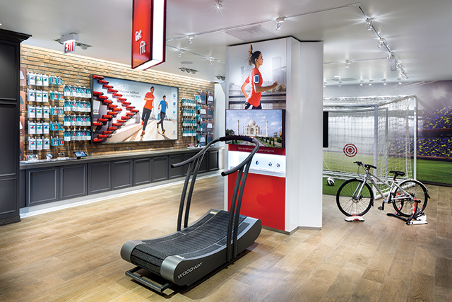 "The ""Get Fit"" zone helps the shoppers test equipment. Here, users test fitness trackers while on the treadmill or bike. In this scenario, an HD display provides content for full immersion in the experience. In users' minds, they aren't in a store testing equipment with hundreds of eyes watching, they are on their Sunday run."