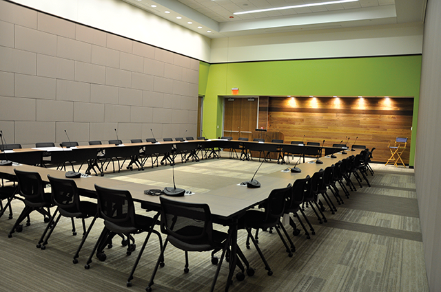 The conference microphones are set up in one of the divisible conference/training rooms.