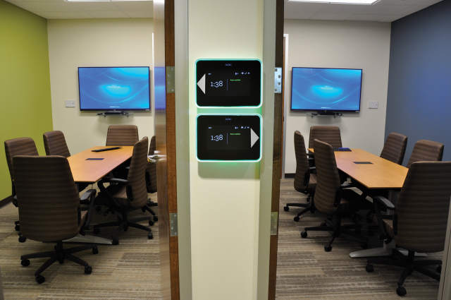 Room Schedulers are mounted outside two of the conference rooms.