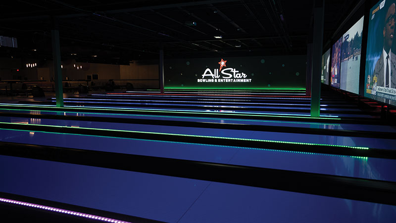 Projection screens behind the lanes and LED TVs above mean bowlers won't miss a second of the action, whether they're watching music videos or March Madness.