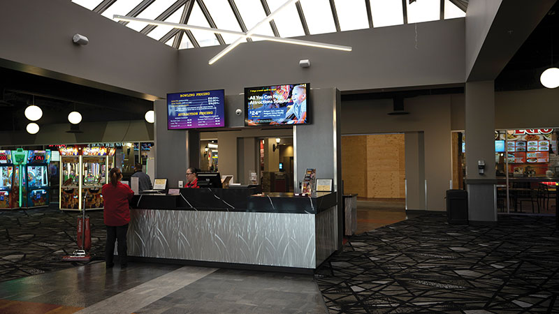 Digital-signage screens greet guests in the lobby of All-Star Bowling.