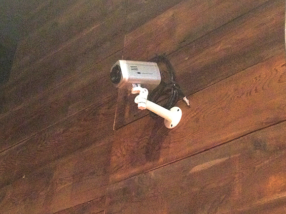 An IP camera mounted on the wall opposite the upstairs stage can send content to any or all of the video displays, letting downstairs diners watch and hear the upstairs bands play live.