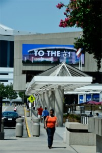 Guests enjoy a stroll along International Blvd. outside the Georgia World Congress Center on a sunny Atlanta day with a 48′x14′ billboard in the background.