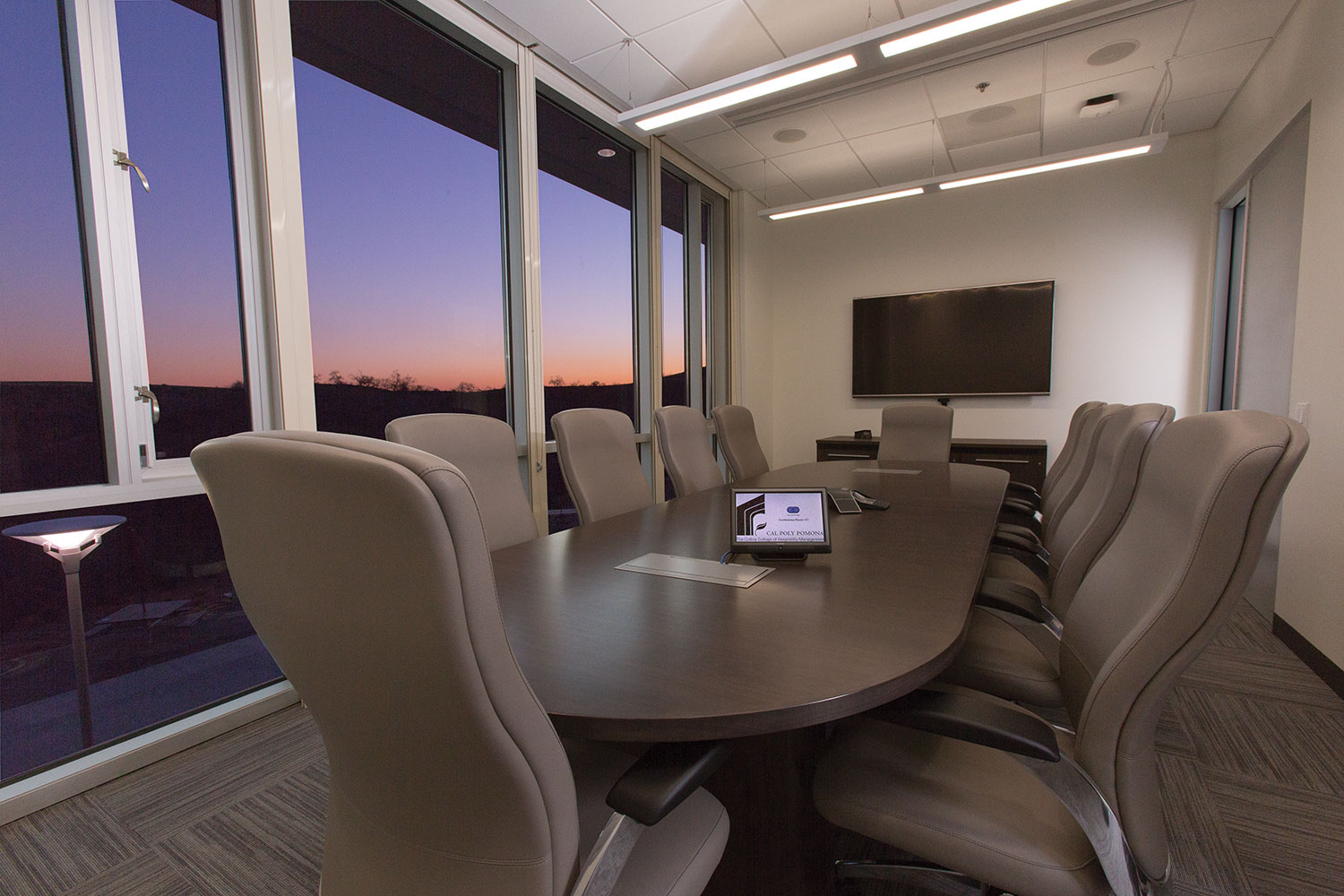 The conference room features a 70-inch display and video camera for meetings and interviews.