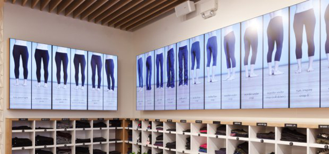 The Digital Pant Wall for Lululemon uses motion sensors to trigger a content change when pant styles sell out.