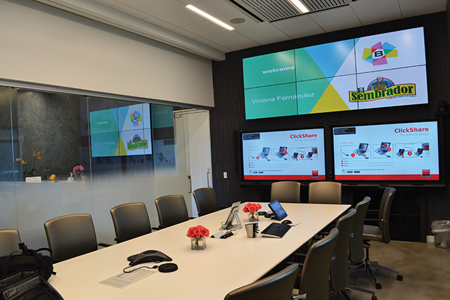 The executive conference room features a six-screen videowall and two 65-inch interactive panels. The lobby's four-screen videowall can also be seen here.
