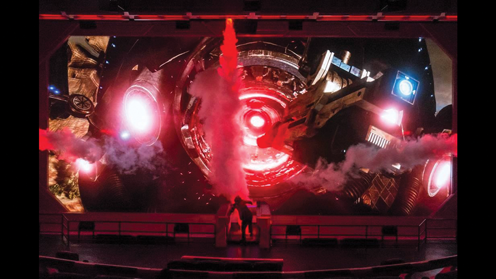 Closing scene of Mass Effect: New Earth, in which a live actor interacts with a 3D film on an LED screen.