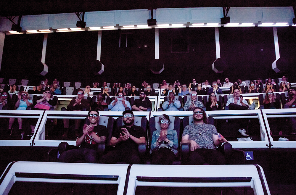 Media preview of the attraction. The author is in the second row, riding with MediaMation's senior management and installation team.