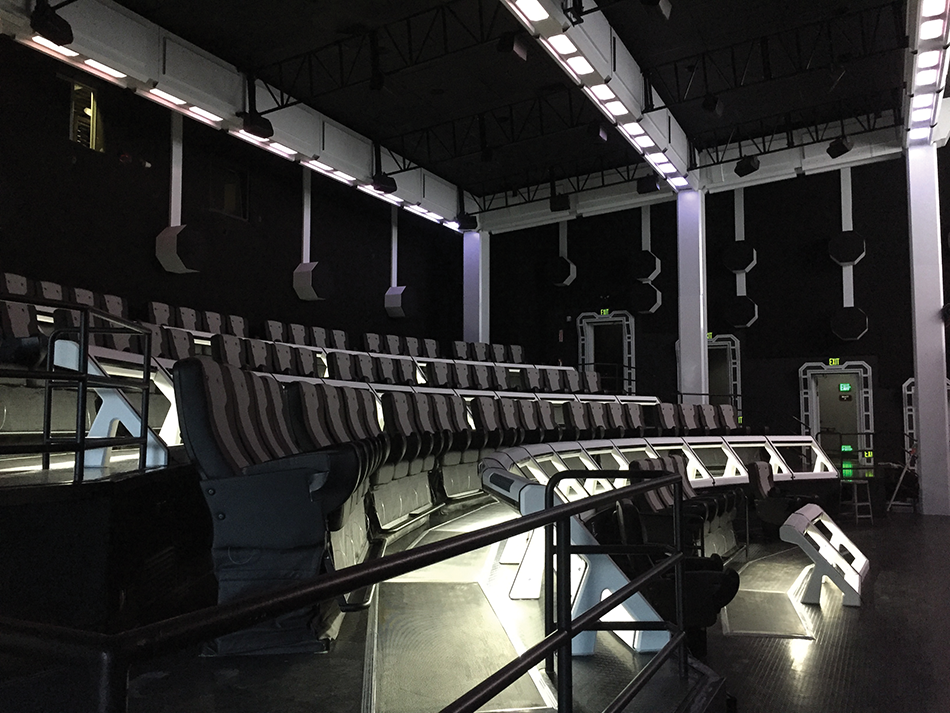 The completed auditorium. Visible are the 70 far-field speakers along the walls and the ceiling truss, the motion effect seats and the Comhear MyBeam near-field audio speakers, located in the bars in front of each seat.