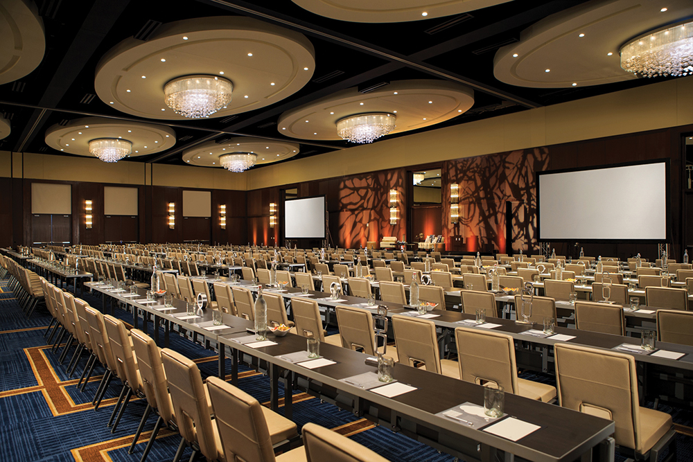 According to Jeff Loether of Electro-Media Design, meeting planners who want venues to look more polished don't want AV components simply wheeled in for events. The AV is present in the Grand Ballroom of the Renaissance Dallas.