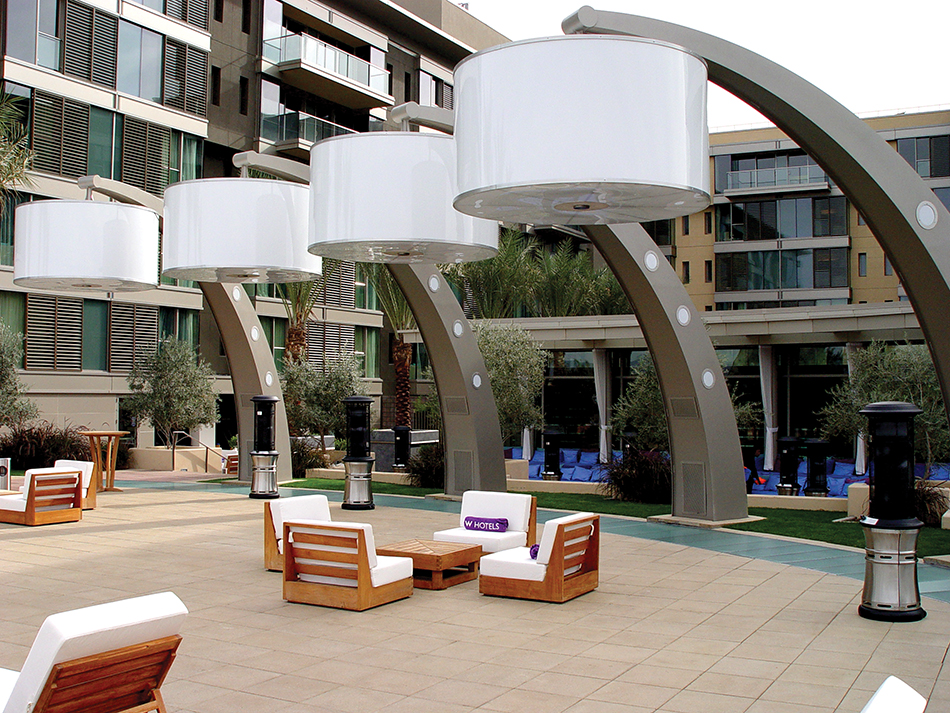 Multiple speakers at the W2 Hotel in Scottsdale AZ are inlayed flush with the outdoor lamps to provide music for those away from the bar.