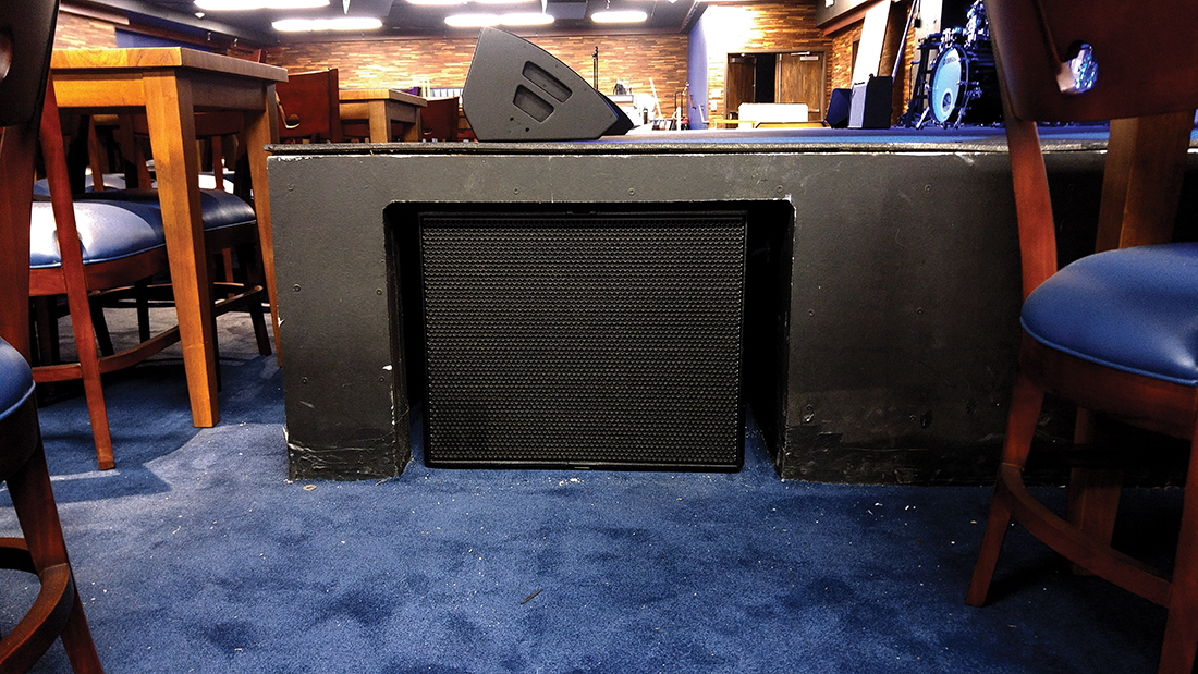 Compact self-cardioid subwoofers mounted under the stage provide smooth low-frequency coverage.