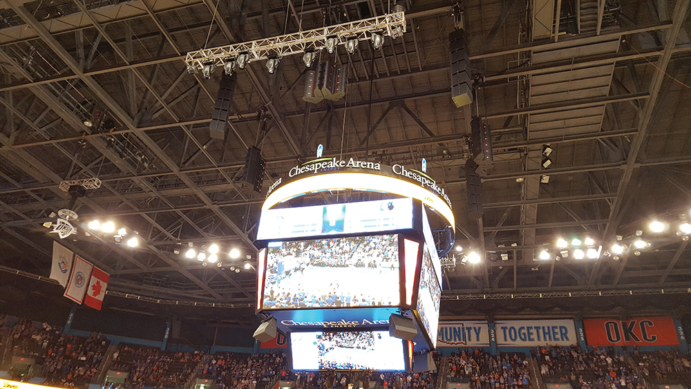 The main loudspeaker arrays consist of two side-by-side columns of adaptive array modules hanging above the sides of the scoreboard. The north and south arrays are six modules high, whereas the east and west arrays are four modules high. Subwoofer arrays hang above the corners of the scoreboard. Four three-way loudspeakers are mounted to the bottom of the scoreboard. These provide down-fill coverage to the closest courtside seats and serve as monitor loudspeakers on the court during timeouts and halftime.