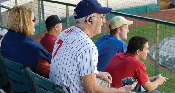 listen-technologies-assistive-listening-man-at-stadium