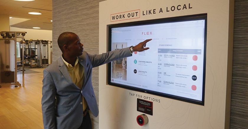 Director of Guest Experience Talib McDowell, Sr., demonstrates the fitness options available to guests. The beta button for the new fitness center is below the LCD touchscreen.