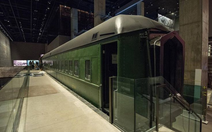 """This Pullman sleeper railroad car was one of two artifacts that were so large that the museum had to be built around them. This illustrates 19th-century African American career options as porters. Audio reinforces the social experience, with eight of the car's original ceiling panels as """"speakers."""""""