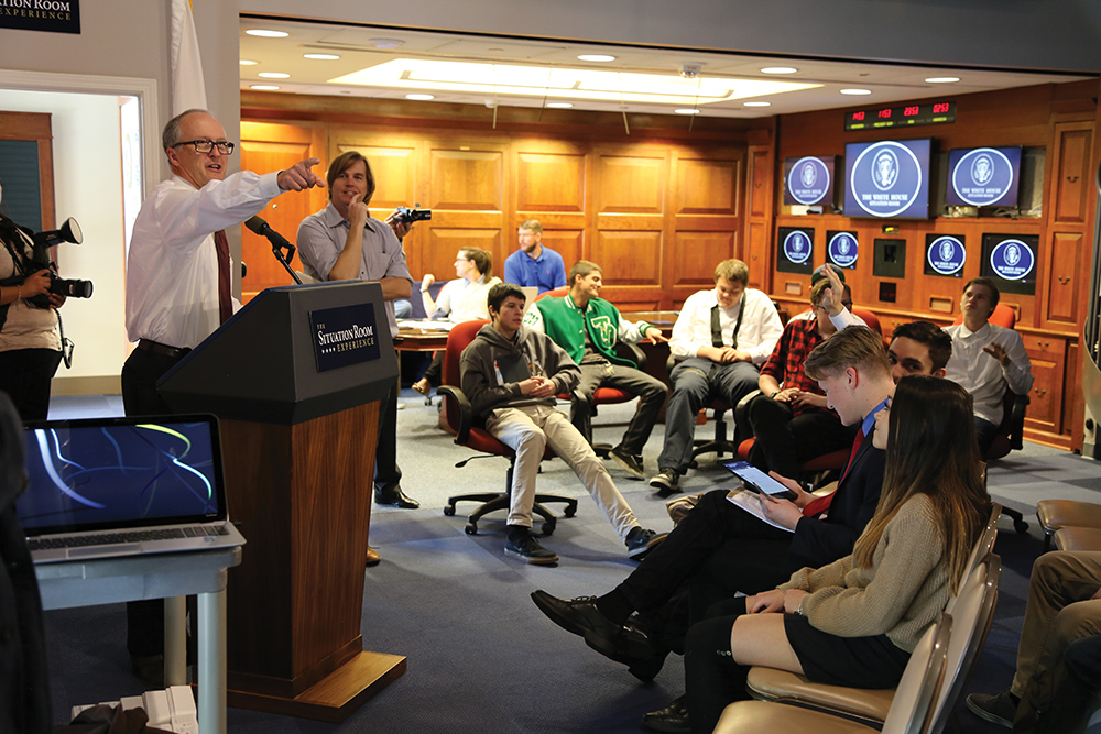 ibrary Director Duke Blackwood takes questions in a debriefing session held in the White House Press Room after a simulation. The retractable pocket-wall that leads to the White House Situation Room is in the closed configuration.