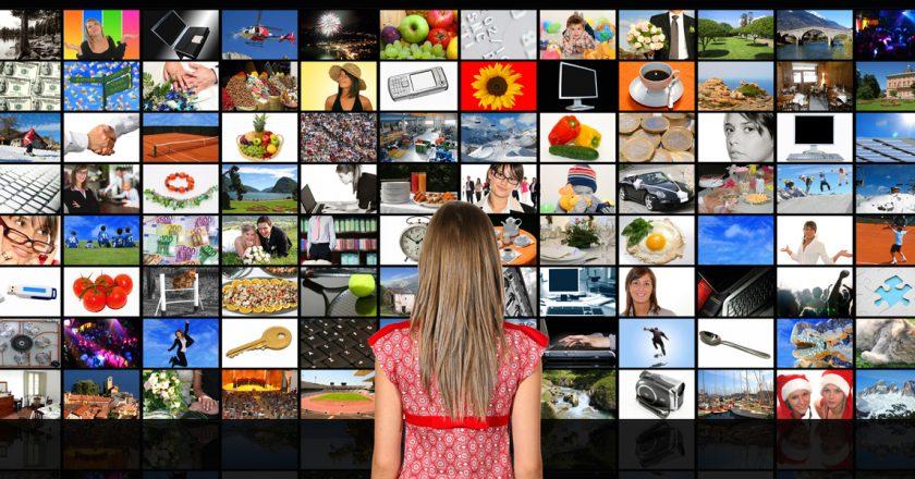 girl looking at multiple video steams