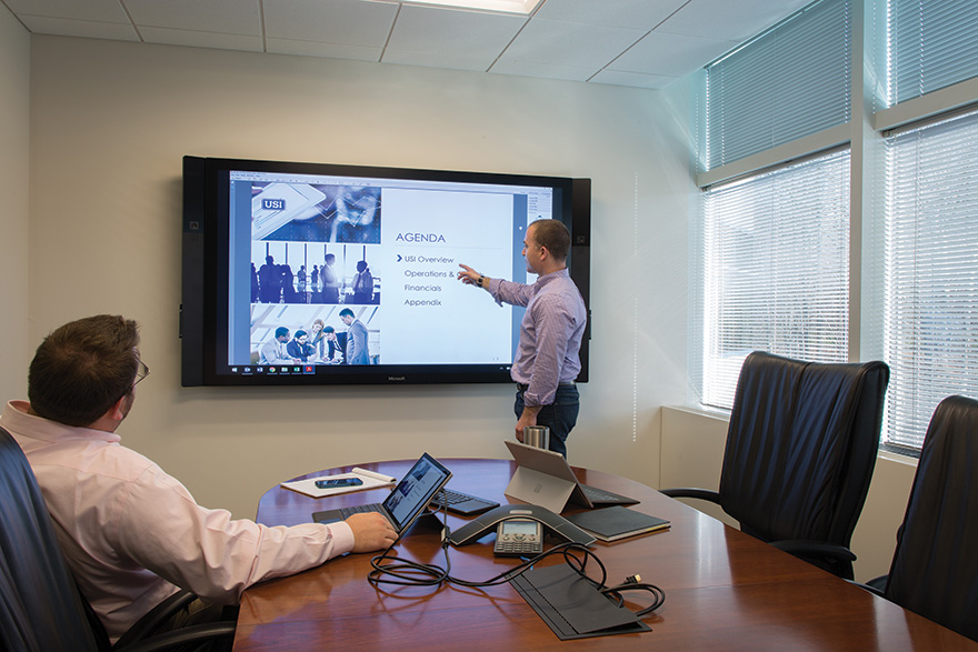 In smaller conference rooms, Atlona's CLSO-824 is integrated alongside a Symetrix Radius AEC DSP with AEC for VoIP support. These spaces are divisible to create smaller training rooms, and presentation content can be mirrored or unique in each room.