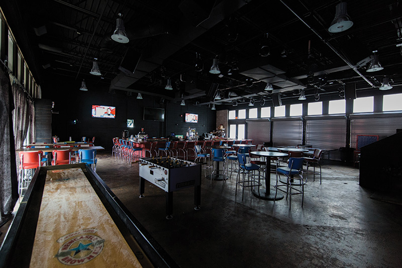 The tables and chairs are moved out of the way at night when the new Green Room DJ-dance area opens up. Three displays are located near or behind the bar, and the DJ roost's turntable can be used to trigger video content.