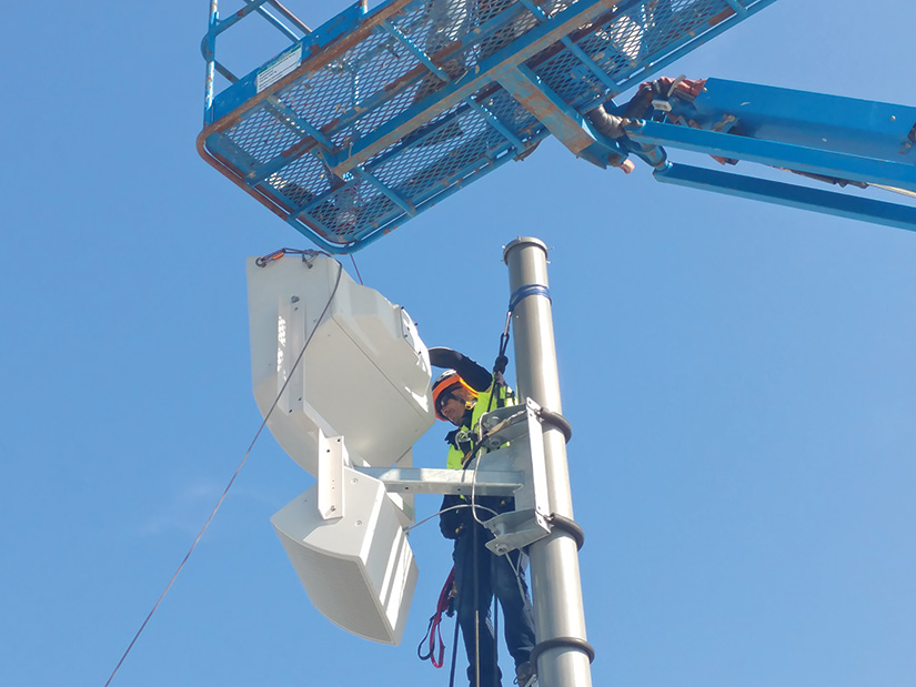 PA speakers being mounted on poles, some of which tower as high as 70 feet above the ground. Covenant's integrators ran the cabling inside most of the poles, mounting the speakers to them using rigging.
