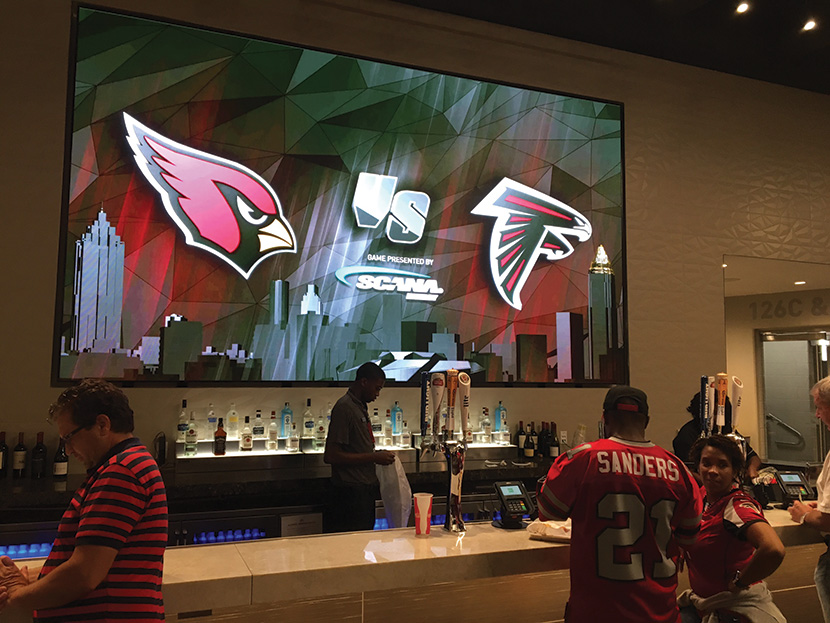 This is the first pro-sports stadium in which the entire video system is IP from the core. Input from the cameras and the graphics are all IP, going out to IP displays, including this stunning one above one of the bars.