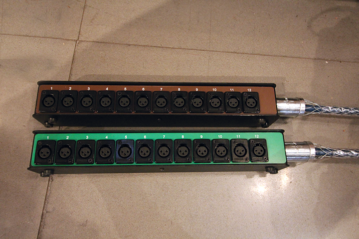 A series of color-coded drop boxes provide inputs for the stage. The approach was familiar to the members of the church's AV oversight committee, who are well versed in touring and rental systems.