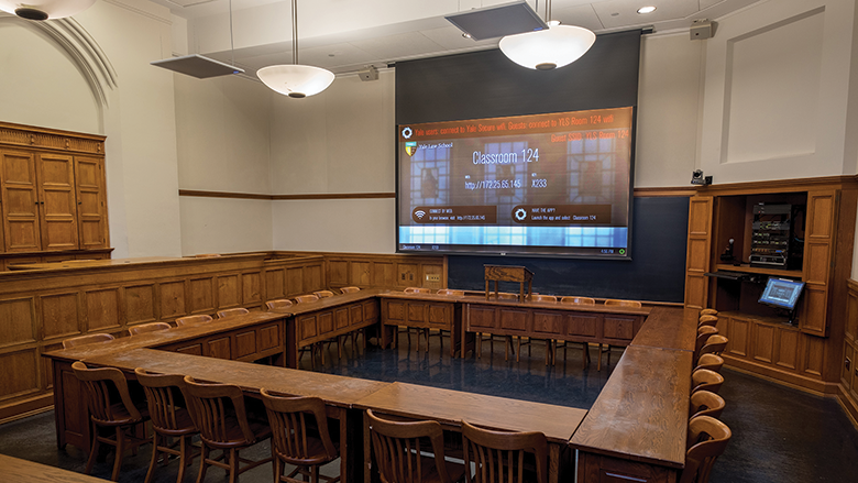 A wide view of Yale Law School classroom 124. The room's equipped with projection, PTZ cameras, microphones and more.