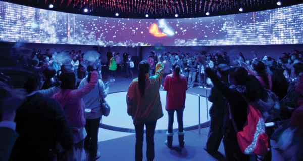 Visitors wave in unison, activating the LED façade and becoming experientially linked to the building, inside the Dream Cube.